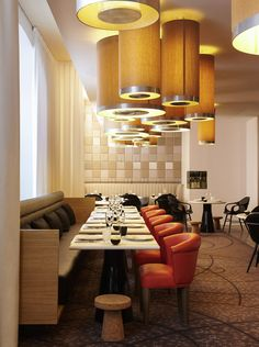 Sofitel Paris Arc De Triomphe White Long Dining Table Modern Red Dining Chairs Black Leather Bench Modern Large Pendant Lights Black Chairs: Historic Hotel Design with Luxurious Visual Appeal