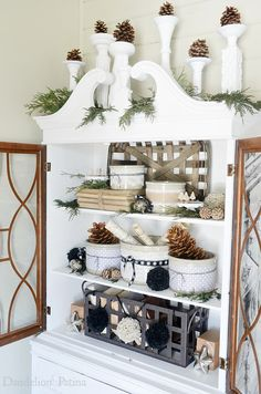 Happy Holidays Home Tour - Dandelion Patina. Love the pinecones in the white vases/candlesticks