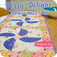 Add a touch of vintage charm to your table with the Dizzy Delight Tablerunner, available as a kit featuring Pam Kitty Love!