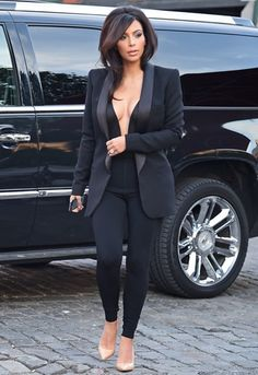 Kim Kardashian is a hot mamma on this plunge-neck jumpsuit from ASOS http://asos.to/TxiHfd