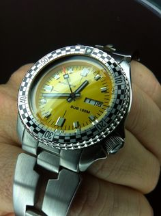 Vintage Seiko 6309-7290 modified with a custom yellow dial and rally diver bezel.