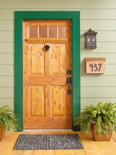 Dark-green trim adds new style to a natural wood door. 20 ways to add curb appeal: http://www.bhg.com/home-improvement/exteriors/curb-appeal/ways-to-add-curb-appeal/