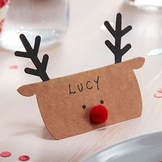 Dress your table in style this Christmas with these Kraft Reindeer shaped Christmas place cards. A great way to ensure your guests are seated in the perfect pl Christmas Place Cards, Christmas Names, Christmas Bunting, Christmas Table Decorations, Christmas Table Settings, Xmas Cards, Kids Christmas, Christmas Crafts, Christmas Place Setting