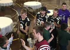 MU football student-athletes receive special experience at HCAC Samaritan's Feet event