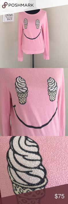 """Wildfox Pink Ice Cream Cone Smiley Sweater XS ADORABLE Wildfox Ice Cream Cone sweater. Very cozy. Apparently these sweaters actually come pre-pilled, so that's not from wear. The only issue and reason why I'm pricing lower is some staining on the cuff which I have pictured. Tried to get it out with tide to go, but I would rather let someone more experienced with stains deal with it. Very sought after sweater brand, it's a hot product right now! Bust: 36"""" Waist: 34"""" Length: 24"""" Arm Length…"""