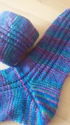 These socks are easy to knit and are a good starting point for anyone who would like to try toe-up technique for the first time. A simple Garter Rib 'tramline' climbs up both sides of each sock, adds… Loom Knitting, Knitting Stitches, Knitting Socks, Knitting Patterns Free, Knit Patterns, Free Knitting, Baby Knitting, Knitting Tutorials, Knitting Machine
