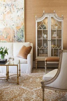 Master Bedroom at Meridian Residences: a vibrant and decidedly feminine residence by Ebanista focusing on exquisite furnishings, each with their own couture-like attitude and detailing. Discover more at http://www.ebanista.com. Saville I Cabinet, Guerlain Cocktail Table, and Rousseau Chair by Ebanista.