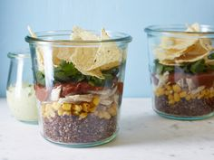 Chicken, Avocado Cream and Quinoa Salad-in-a-Jar : Enjoy a layered lunch with this portable, Mexican-inspired quinoa salad. To save time, make a big batch of quinoa, and freeze portions in resealable bags for up to 1 month. Having a whole-grain arsenal in your freezer will help cut down on prep time later. via Food Network