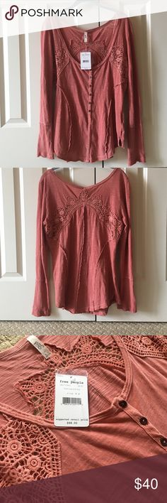 NWT Free People Terracota Top NWT Free People terracotta top, size Medium. Beautiful detailing on back and along chest. This shirt is cut fairly low and a little tight. Buttons go almost all the way down the shirt, which has an extra button on the tag. Feel free to ask questions or for more pictures! Happy Poshing 🎀🛍 Free People Tops Blouses