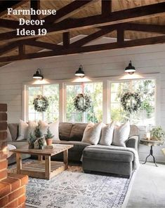 Rustic farmhouse living room design and decorating ideas (love the wreaths on the windows!)