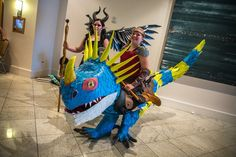 Dragon*Con is known as the cosplay capital of the country--the very best and creative costumes debut at this four-day celebration of fandom before their makers take them on the convention circuit. Among classic costumes and familiar faces, some new groups and themes I saw this year included characters from Jurassic World, Mad Max, and even the upcoming Star Wars: The Force Awakens. Creative mash-ups and spoofs are maybe my favorite part of this convention, and those groups delivered. Let me…