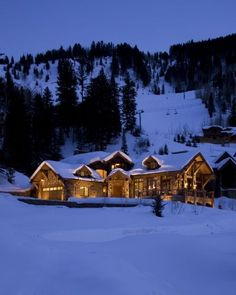 A home in Aspen, Colorado looks like a dream destination surrounded in nothing but white snow and tall trees.