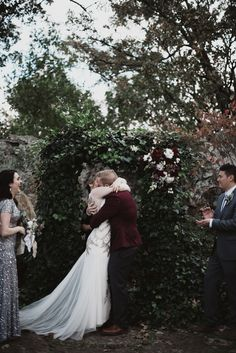 Scene-stealing first kiss from this silver and burgundy wedding ceremony at Skelly Lodge | Image by a sea of love