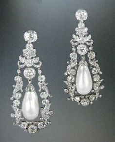Known as the Duchess of Gloucester's Pendant Earrings, these beauties now belong to Elizabeth II and seem to be one of her favourites, given how often share wears them. Originally belonging to Princess Mary, Duchess of Gloucester (1776 - 1857), c. 1840 in silver and gold with pearls and diamonds. The tops were originally black pearl studs.