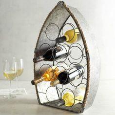 Boat Wine Rack $49.... http://www.completely-coastal.com/2016/03/wine-bottle-racks-coastal-nautical.html