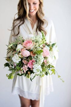 A fun pink and white wedding bouquet that is lively and just the right amount of girly