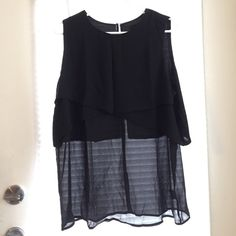 Chiffon layered Black sleeveless tank top blouse Chiffon layered Black sleeveless tank top blouse - chic & flowy top - double layered & scoop neckline - pair with just about anything! jeans, shorts, skirts! awesome top :) sized XXL but fits comfortably for an XL Tops Tank Tops