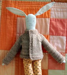 free pattern for a small doll-size sweater, and, the rabbit is a free sewing pattern here:  http://purlbee.squarespace.com/the-purl-bee/2007/1/4/a-friend-for-the-purl-bee-purl-rabbit.html