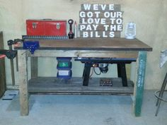 Recycled wood pallets & an old wood door made into a completely free work bench.