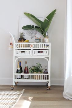 Happy Hour in Paradise: Summer Bar Cart Styling | House Full of Summer - Florida bar cart decor, tropical themed party, tiki bar styling, coastal decor dining room entertaining, LVP wood floors, fresh palm fronds, palm leaves, giant bird of paradise, Decorating On A Budget, Porch Decorating, Interior Decorating, Bar Cart Styling, Bar Cart Decor, Coastal Homes, Coastal Decor, Drawing Rooms, Palm Fronds