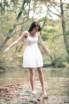 Senior pictures -- I like the barefoot and sundress with the water idea (: