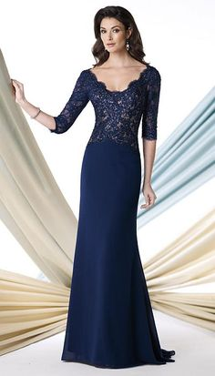Montage 213978 Three Quarter Sleeve Evening Dress- This chiffon and lace A-line evening dress has three-quarter length sleeves, scalloped tip-of-the-shoulder scoop neckline, hand-beaded lace bodice with deep open back. This style is also available in Plus (Women's) sizes 16W - 26W. Colors: Navy Blue/Nude, Rose, Black, Oyster