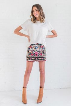 DETAILS: - Beautiful embroidery over the entire skirt - Fully lined - Runs small, size up - Model is wearing a small MEASUREMENTS: Length(Cm): S:37cm, M:38cm, L:39cm Hip Size(Cm): S:90cm, M:94cm, L:98
