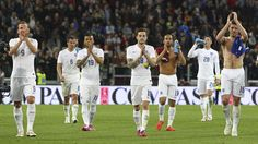The England players salute the fans at the end of the international friendly against Italy