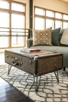 """An old suitcase fashioned into a coffee table not only serves as an element of intrigue but provides storage for books, blankets and other great room accessories. """"I think suitcases are so iconic,"""" says design coordinator Laurie March. """"They tell you that you are going somewhere; that you've landed."""""""