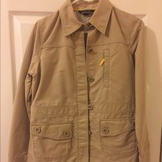 Lands' End casual jacket. Lands' End casual weekend jacket. Lots of pockets. Button closure. Cute little zip pocket in the back. Great for hiking. Tiny red stain in the back (see last picture). Lands' End Jackets & Coats Utility Jackets