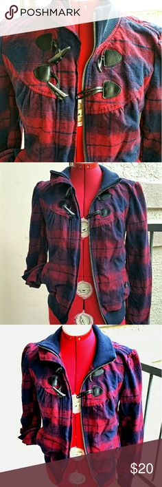 """Plaid Flannel Jacket - NWOT A nice, heavyweight burgundy & navy flannel, with zipper and toggle closure, stretch band collar, cuffs, & bottom band. Front and back yoke is gently gathered. Small, buttoned front pockets. This looks to be new/unworn. Rubbish, tag size MEDIUM, however the fit is SMALLER!  Measure something similar that fits you (remember to leave room for movement!) and compare with these measurements: 14.25"""" across shoulders, 18"""" pit to pit, 23"""" length from shoulder to bottom…"""