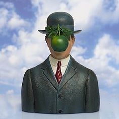 £35.00 Son of Man Sculpture  'Everything we see hides another thing, we always want to see what is hidden by what we see'  René Magritte (1898-1967). Painted sculpture based on 'The Son of Man', from 1964 by the Belgian surrealist artist, known for his witty and thought-provoking images.