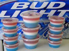 4th of July Jello Shots....1. Blue Raspberry jello with Vodka 2. Cool Whip 3. Cherry Jello with Vodka....very cool!