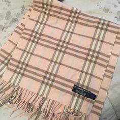 Burberry Pink 100% cashmere scarf Authentic Burberry Pink 100% cashmere scarf- please ask all questions prior to purchase.  Light pink, white, and blue shades within the print.  About the length of the width of a queen size bed.  Very Lightly worn, no pulls or stains. Sorry no trades ☺️ Burberry Accessories Scarves & Wraps