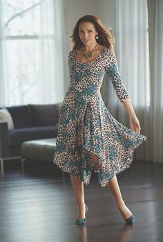 Floral Animal Print Dress from Midnight Velvet.   Teal blossoms pop against a background of neutral animal print, with a sassy asymmetrical waistline and hankie hem.