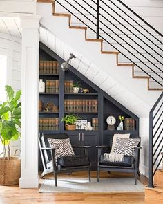 Vintage graphite grey bookcase under the stairs for a comfy reading nook