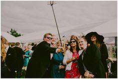 2015 was truly the year of the selfie-stick at weddings.  Leave a few dotted around the reception venue to guarantee an ice-breaker and lots of candid photos of your guests.  #weddingprops #weddingreception Images by Lucabella. www.lucabella.co.uk