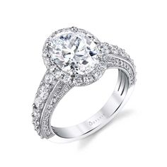 This bold and glamorous oval engagement ring features a 3 carat oval shaped center stone with a tapered shank of lustrous diamonds cascading down each side. Complimented by a stunning side profile of diamonds and milgrain detailing, this bold oval engagement ring has a total weight of 1.47 carats. Sylvie Collection Oval Shaped Engagement Rings, Vintage Style Engagement Rings, Unique Diamond Engagement Rings, Antique Wedding Rings, Engagement Ring Shapes, Perfect Engagement Ring, Halo Engagement Rings, Designer Engagement Rings, Diamond Rings
