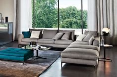 Occasional tables and corner sofa by Minotti