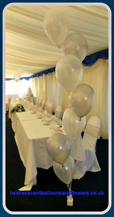 Stunning floor standing silver and white balloon arrangement.
