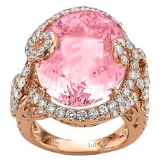 This stunning oval 18.63ct Morganite center stone is sure to be a head turner. The magnificent stone is set in 18k rose gold and tastefully accented with .63tw round brilliant diamonds in a very unique setting. This ring is a Juleve ring and is exclusive to Gold & Diamond Source