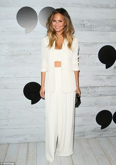 Oh Mrs Legend! Chrissy Teigen stunned in an all-white ensemble made of flowy pants and a c...