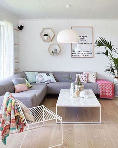 This is a really nice colourful take on Scandi-inspired decor. The blanket and cushions really add warmth to an otherwise minimal space.