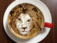 Amazing Latte Art. Think how fast the artist must have made all those small lines before the ones he'd already made could distort.