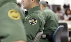 U.S. Customs and Border Protection agents sharing information in Brownsville,Texas.