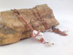 Check out this item in my Etsy shop https://www.etsy.com/listing/275437488/copper-wire-wrapped-mother-of-pearl