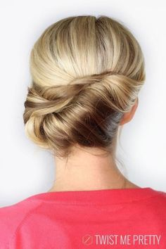 Blonde updo with small pompadour and braid tucked into a horizontally rolled French Twist