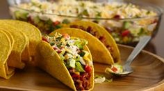 Tacos are easy and make great party food. Seasoned ground beef tacos topped with lettuce, peppers, roasted corn, onions, tomatoes and avocado. Crock Pot Recipes, Slow Cooker Recipes, Chicken Recipes, Cooking Recipes, Slow Cooking, Crockpot Ideas, Turkey Recipes, Quesadillas, Mexican Dishes