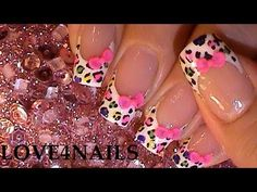 I like the animal print design and the colors.  Don't care about the bow.  How to Make an Easy 3-D Bow on a Rainbow Animal Print Nail Design - YouTube