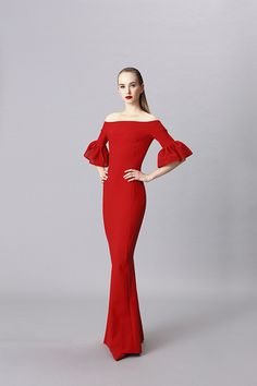 Stretch jersey gown. Plain, off-the-shoulder, ¾ sleeves with techno lace tulip cuffs, mermaid silhouette. Raw edge hem for ease of tailoring, will...
